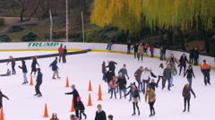 Tilt shot of skating rink in central park. Stock Footage
