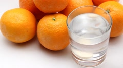 Effervescent Vitamin C tablet dissolves in glass of water Stock Footage