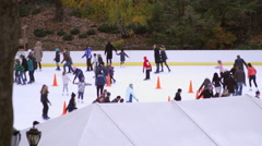 Sow panning shot of ice rink in central park. Stock Footage