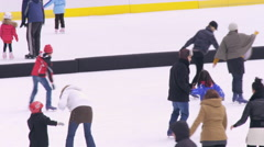 Slow motion shot of ice skaters on the Central Park ice rink in New York City. Stock Footage