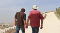 Two Men Walking Up The Ancient Herodium, Herod the Great's home Stock Footage