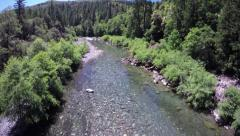Aerial shot flying over a wilderness river in Southern Oregon Stock Footage