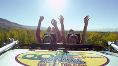 Roller coaster creasting the top of the climb and accelerating down the tack. - stock footage