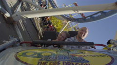 Stock Video Footage of Slow motion shot of a couple riding a rollercoaster