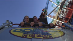 Hood shot of front seat of rollercaoster upside down. - stock footage