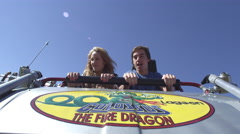 Shot of couple in front seat of rollercaster as the cart comes to a stop. Stock Footage