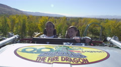 A slow motion of a couple riding a roller coaster. - stock footage