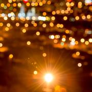 Abstract circular bokeh background, city lights in the twilight with streetli Stock Photos