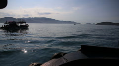 view of vietnamese tourist boats drifting to islands for diving - stock footage