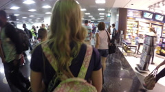 4K walking through a very busy Miami airport terminal Stock Footage