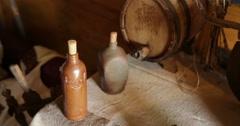 Ukrainian authenticity. Home village. Old bottles, barrel, roaster Stock Footage