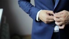Stylish man in a suit buttoning jacket. Close up - stock footage