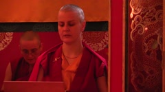 Monastery. pujas recited by Tibetan monks. Close up woman - stock footage