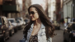 Fashionable woman standing on street after a haircut Stock Footage