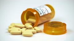 Yellow pills in an open prescription bottle. Stock Footage