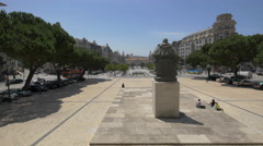 Relaxing near the Statue of Almeida Garrett in front of the city hall of Porto Stock Footage