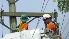 Hydro Linemen Discussing Problem On Job Site - stock footage
