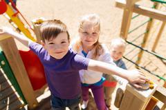 Group of happy kids on children playground Stock Photos