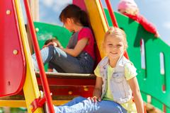 happy kids on children playground - stock photo