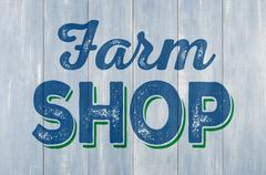 Blue wooden wall with the inscription Farm Shop - stock photo