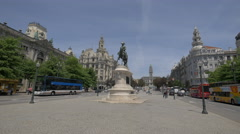 Buses near the statue of Dom Pedro IV in Porto Stock Footage