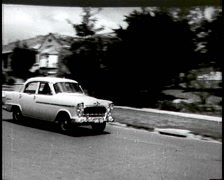 Old Car Driving Through Suburban Street (Archival Footage) Stock Footage