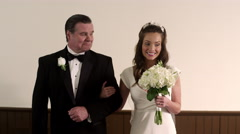 Shot in front of a father and bride walking down the aisle. Stock Footage