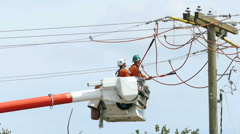 Two Hydro Linemen Repairing Wires On Telephone Pole Stock Footage