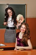 Teacher and pupil in the anatomy lesson. Stock Photos