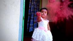 little girl throwing color - stock footage
