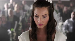 Bride without a groom looking sadly up at a preacher. Stock Footage