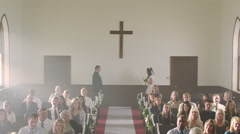 Bride smiling at the front of a chapel despite her missing groom. Stock Footage