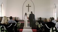 Bride and groom smiling as a preacher talks to them in the chapel. Stock Footage