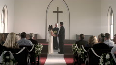 Newlywed couple kisses and walks down the aisle. Stock Footage