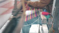 Crafter in loom making fabric Stock Footage