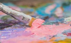 pink paint brushes and oil paints - stock photo