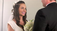 Preacher talking with a bride and groom. Stock Footage
