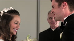 Preacher reading to a bride and groom. Stock Footage