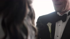 Groom facing the bride as they listen to the preacher. Stock Footage