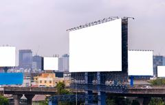 large blank billboard with city view background - stock photo