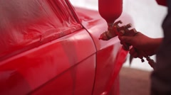 Painter paint the red car in garage Stock Footage