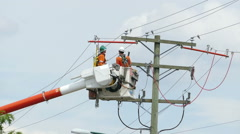 Two Hydro Linemen Repairing Old Wires On Telephone Pole Stock Footage