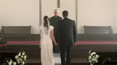 Newlywed couple kisses, turns, and walks down the aisle. Stock Footage