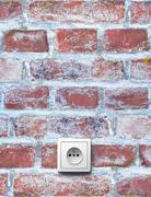 old red brick wall with electrical outlet - stock photo