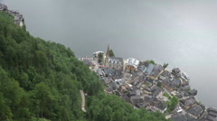 Hallstatt alps village and lake from above clouds timelapse Stock Footage