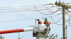 Two Hydro Linemen In A Crane Bucket Stock Footage