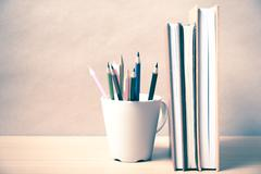 Stand up book with color pencil Stock Photos