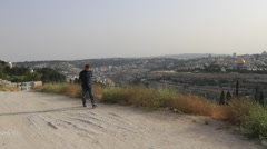 Young Man Walking on the Mount of Olives Jerusalem, Israel Stock Footage