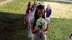 Slow-motion bride throwing bouquet of flowers. Stock Footage