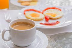 Hot Coffee with Happy Face Frying Eggs breakfast Stock Photos